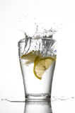 Lemons. Three lemons are falling into the glass of water Royalty Free Stock Photography