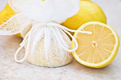 Lemons Tied in Cheesecloth. Lemon halves ready to be served with fish, tied in cheesecloth so that when the lemon is squeezed the juice will be released, but the Royalty Free Stock Photo