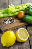 Lemons and vegetables on table. Recent shot of Lemons and vegetables on table stock images