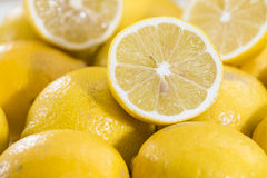 Lemons on vintage wooden background Stock Photography