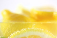 Lemons in water with bubbles. Fresh lemons in water with bubbles stock photo