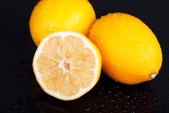 Lemons on wet table Stock Images