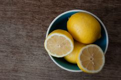 Lemons. On a wooden table Stock Image