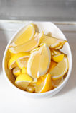 Lemons in white bowl Royalty Free Stock Photo