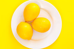 Lemons on a white plate Royalty Free Stock Image
