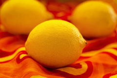 Lemons. Whole lemons on colorful background Stock Photos