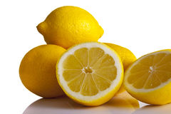 Lemons whole and halved front on Royalty Free Stock Photos