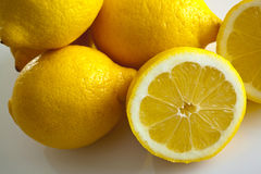 Lemons whole and halved top view Stock Photography