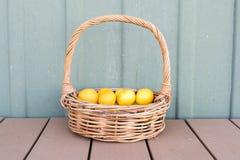 Lemons in wicker basket Stock Photos