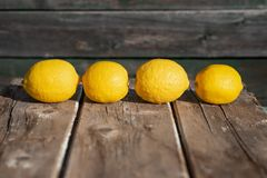 Lemons on a wood background royalty free stock images