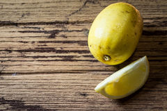 Lemons on wooden backgound Stock Image