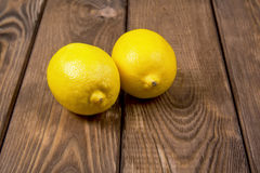 Lemons on a wooden background Royalty Free Stock Photos