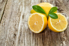 Lemons on a wooden board. Royalty Free Stock Images