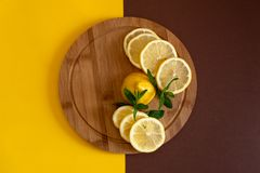 Lemons. On a wooden board royalty free stock photo