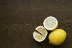 Lemons on a wooden board Stock Images