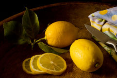 Lemons in a wooden bowl Royalty Free Stock Image