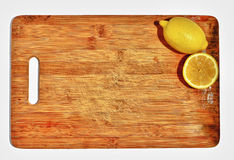 Lemons on wooden cutting board Stock Photos