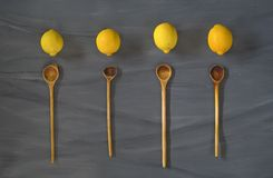 Lemons and wooden spoons, Stock Photo