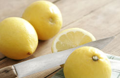Lemons on wooden table Royalty Free Stock Photos