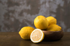 Lemons on a wooden table Stock Photos