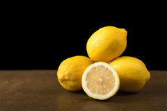 Lemons on a wooden table Stock Image