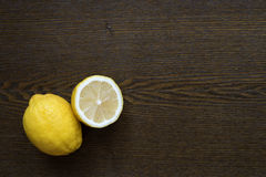 Lemons on a wooden table Royalty Free Stock Photos