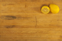 Lemons on Worn Butcher Block Stock Images