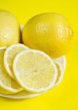 Lemons on the yellow background Stock Photo
