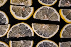 Lemons yellow with black background stock photos