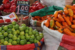 Lemons and yellow pepper for sale in popular market. Royalty Free Stock Photo