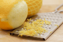 Lemons and Zest With Grater. Royalty Free Stock Photo