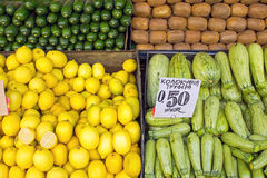 Lemons, Zucchinis and Kiwis. Seen on a market royalty free stock images