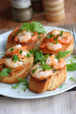 Lemony prawn bruschettas Stock Photography