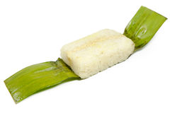 Lemper Ayam. Opened lemper ayam in banana leaves with white background royalty free stock image