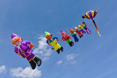 Lemwerder, Germany - August 18th, 2018 - A row of kites strung together depicting Snow White and the seven dwarfs at the Lemwerder. Kite Festival stock images