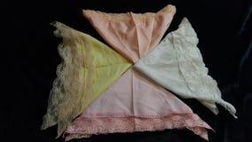 4 lenços laçado dobrados do vintage pastel foto de stock