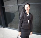 Lena. Business suit, glasses, city, half height! Stock Image