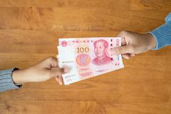 Free Lend Or Giving Money Concept. Top View Hand Giving Banknote Currency Chinese Yuan (CNY Or RMB Stock Photos - 168264153