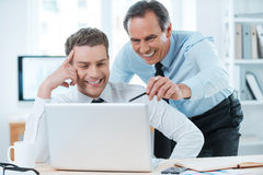Lending him a hand with his work. Royalty Free Stock Photography