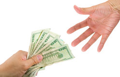 Lending Money. A hand lending money or handing over money to another hand, on white with clipping path Royalty Free Stock Image