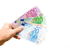 Lending money. Keeping in hand some euro banknotes Royalty Free Stock Photo