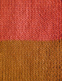 Length of stockinette stitch knitting in pink and brown yarn Royalty Free Stock Photo