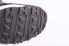 Lenguados viejos de los zapatos usados para entrenar en un fondo blanco Imagen de archivo libre de regalías
