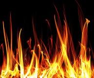 Lenguajes de la llama en un fondo negro, backgrou stock de ilustración