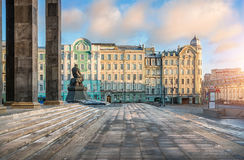 Lenin Library in Moscow and monument to Dostoevsky. On a sunny winter day Royalty Free Stock Photography