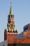 Lenin Mausoleum and Kremlin`s tower at Red Square. In Moscow Russia on the background of blue sky Stock Image