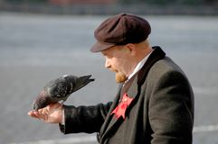 Lenin and pigeon Stock Images