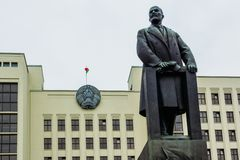 Lenin sculpture in Minsk, Belarus. Lenin sculpture on the background of the government building in Minsk Belarus royalty free stock image