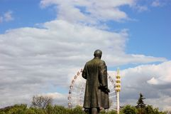 Lenin statue looking at Ferris wheel, Moscow Royalty Free Stock Photography