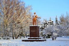Lenin in the winter. Lonely you stand, covered with snow And around you quiet, the world is so huge You dreamed of conquering this world crazy And now you stand royalty free stock photo